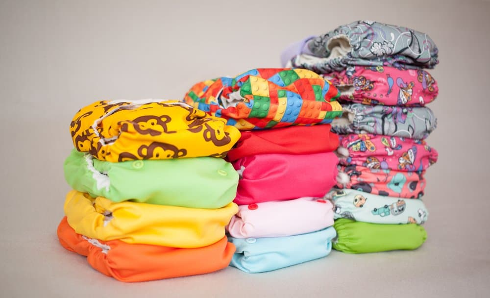 Stack of many cloth diapers, different colors